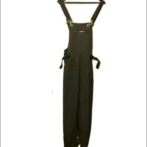 Army green utility jumpsuit with web belt straps